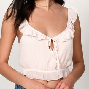 Blush ruffle crop top blouse.
